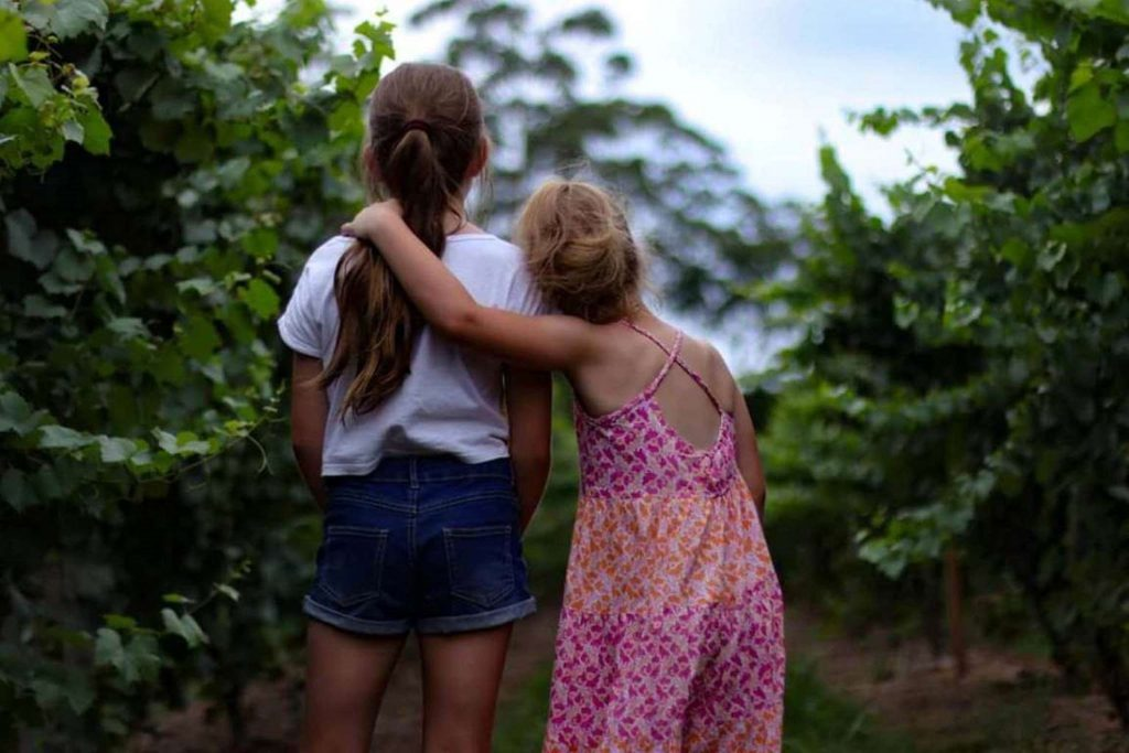 Two girls standing together